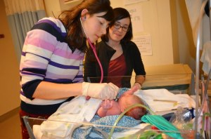 Ottawa Valley Midwives caring for a newborn